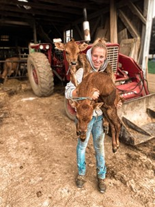 Sharla holding calves
